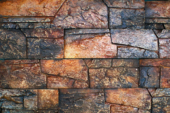 О фасадной плитке под камень, её особенностях
