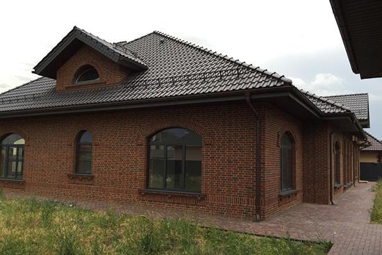 Облицовочный коричневый кирпич: долгий срок службы и безупречный вид зданий