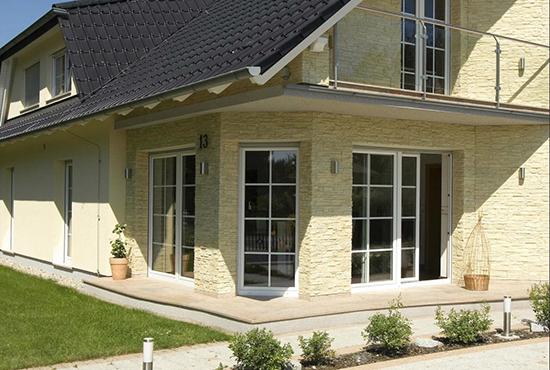 Фасадный камень: особенности, варианты отделки и стоимость материалов