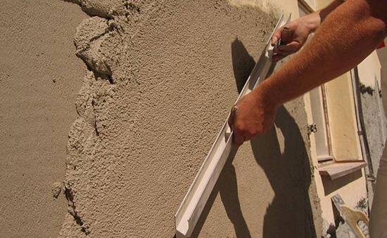 Особенность, применение и изготовление цементных штукатурок фасада