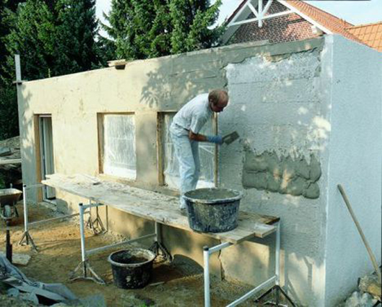 Наружное оштукатуривание дома из пеноблоков