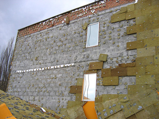 Как утеплить фасад дома под штукатурку