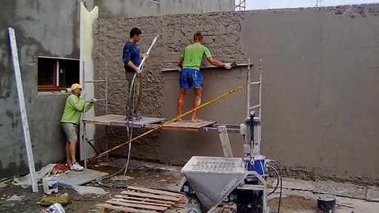 Особенности машинного способа штукатурки фасадов